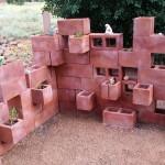 Cantilevered cinder block succulent garden